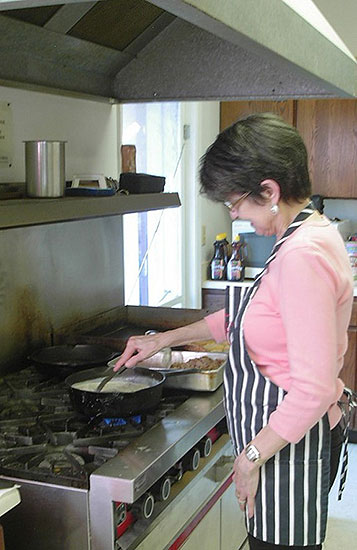 The volunteer staff is kept busy cooking.